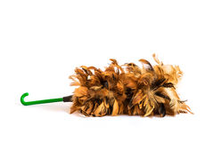 Brown feather duster with plastic handle Stock Photos