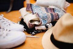 Brown Fedora Hat Beside White Sneakers and Blue Textile Royalty Free Stock Photography
