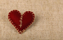 Brown felt craft heart over canvas close up Stock Image