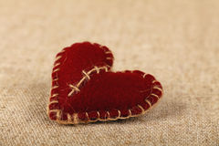 Brown felt craft heart over canvas close up Royalty Free Stock Image