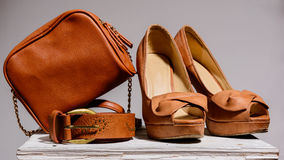 Brown female bag with shoes  and belt Royalty Free Stock Photography