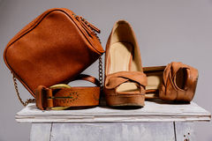 Brown female bag with shoes  and belt Royalty Free Stock Images