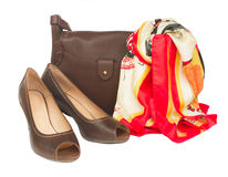 Brown female bag with shoes and scarf Stock Photos
