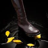 Brown female boot splashing water Royalty Free Stock Photography