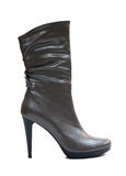 Brown female leather boot Royalty Free Stock Image