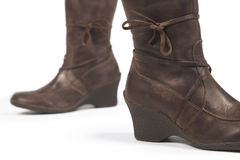 Brown female leather boots isolated on white Royalty Free Stock Photo