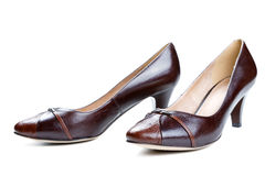 Brown female shoes isolated on a white Royalty Free Stock Photography