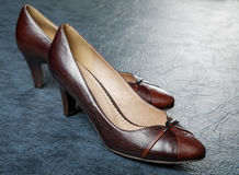 Brown female shoes a leather Stock Photo