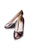 Brown female shoes on a white background Stock Images