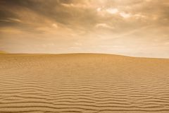 Brown Field of Sand Under Dark Sky during Daytime Royalty Free Stock Photos