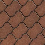 Brown Figured Pavement with Decorative Wave Royalty Free Stock Photos