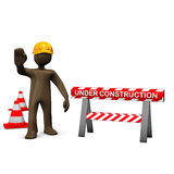 Brown figurine, construction worker, under construction Royalty Free Stock Image