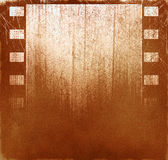 Brown film background. Brown grunge background with film strips and scratches Royalty Free Stock Photos