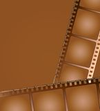 Brown film outline 2. Two pieces of aged brown film layed in different directions Royalty Free Stock Photography