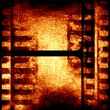 Brown filmstrip. Grunge brown filmstrip with some spots and stains on it Royalty Free Stock Image