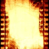 Brown filmstrip. Grunge brown filmstrip with some spots and stains on it Royalty Free Stock Photo