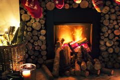 Brown Beside Fireplace Near Brown Wicker Basket Royalty Free Stock Photos