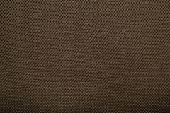 Brown fishnet cloth material as a texture background. Royalty Free Stock Images