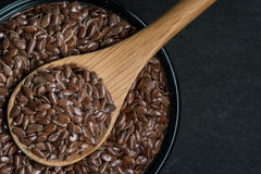 Brown Flax Seed in Bowl with Wooden Spoon and Small Copy Space Stock Photos
