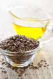 Brown flax seed and linseed oil Royalty Free Stock Image