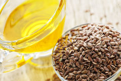 Brown flax seed and linseed oil royalty free stock images