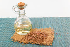 Brown flax seed and linseed oil Stock Photos