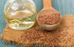 Brown flax seed and linseed oil Royalty Free Stock Photo