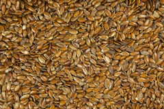 Brown flax seeds background. Stock Photos