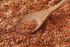 Brown flax seeds background Stock Photography