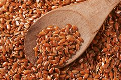 Brown flax seeds background Royalty Free Stock Images