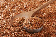 Brown flax seeds background Stock Photos