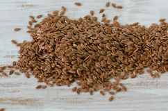 Brown flax seeds close-up top view stock photography