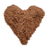 Brown flax seeds forming a heart Royalty Free Stock Image