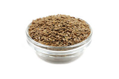 Brown flax seeds in a glass container Stock Photos