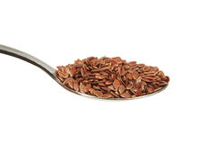 Brown flax seeds on a teaspoon Stock Image