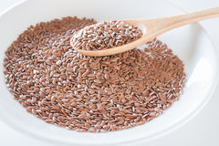 Brown flax seeds on a wooden spoon Royalty Free Stock Photo