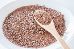Brown flax seeds on a wooden spoon Royalty Free Stock Images