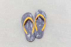 Brown flip-flops on sandy ocean beach, summer and vacation conce Stock Photo