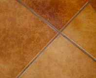 Brown floor tiles. In a kitchen Royalty Free Stock Image