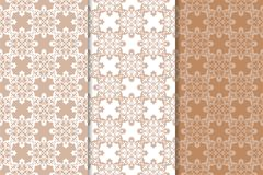 Brown floral backgrounds. Set of seamless patterns. For textile and wallpapers Stock Photo