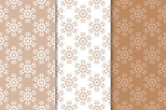 Brown floral backgrounds. Set of seamless patterns. For textile and wallpapers Royalty Free Stock Photo