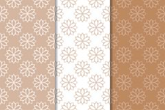 Brown floral backgrounds. Set of seamless patterns. For textile and wallpapers Royalty Free Stock Photos