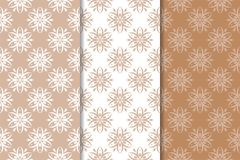 Brown floral backgrounds. Set of seamless patterns. For textile and wallpapers Royalty Free Stock Images