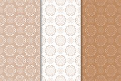 Brown floral backgrounds. Set of seamless patterns. For textile and wallpapers Stock Photography