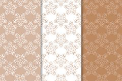 Brown floral backgrounds. Set of seamless patterns Stock Image