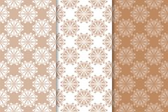 Brown floral backgrounds. Set of seamless patterns. For textile and wallpapers Royalty Free Stock Image