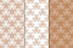 Brown floral backgrounds. Set of seamless patterns. For textile and wallpapers Stock Image