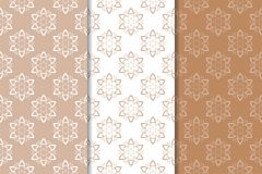 Brown floral backgrounds. Set of seamless patterns. For textile and wallpapers Stock Images