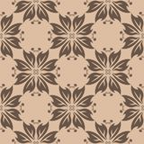Brown floral ornament on beige background. Seamless pattern Stock Photo