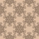Brown floral ornament on beige background. Seamless pattern. Brown floral design on beige background. Seamless pattern for textile and wallpapers Stock Photography